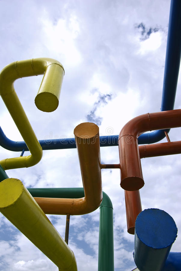 Networking. Colored pipes network against blue sky stock photo
