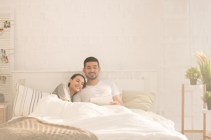 Networking in bed stock photography