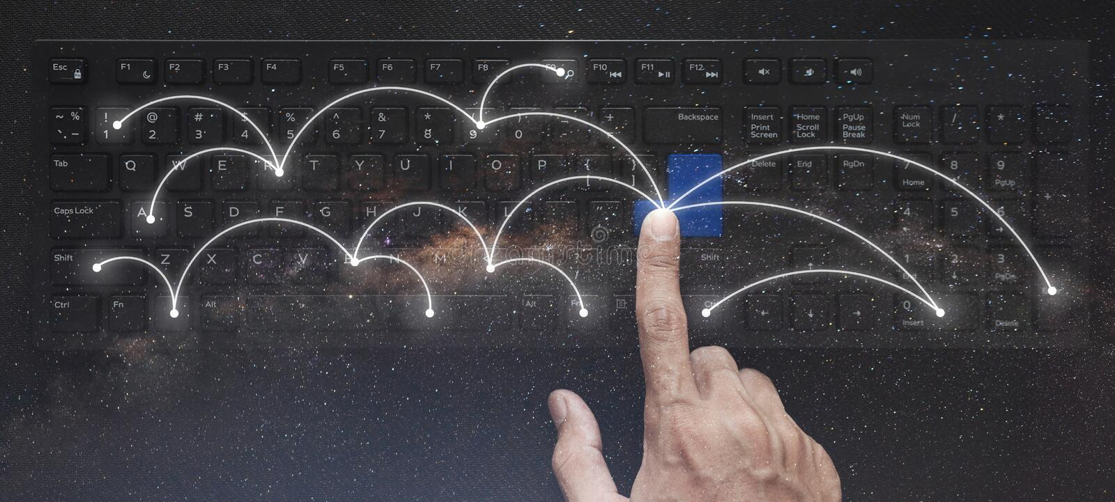 Networking and connection technology, Hand pressing on computer keyboard with double exposure starry background. S stock images