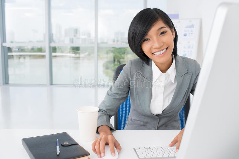Networking. Portrait of a secretary networking at office royalty free stock photos