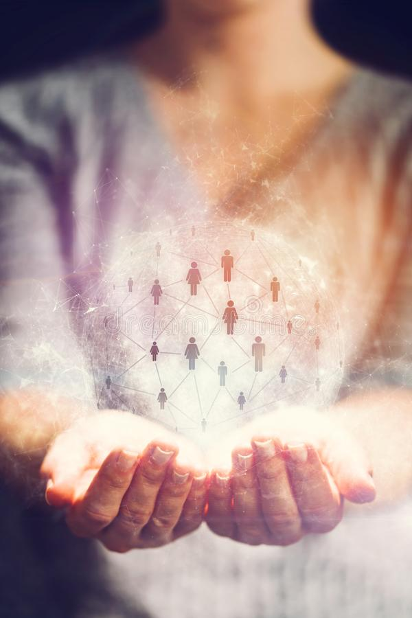 Networking symbol in a hologram in woman`s hands royalty free stock images