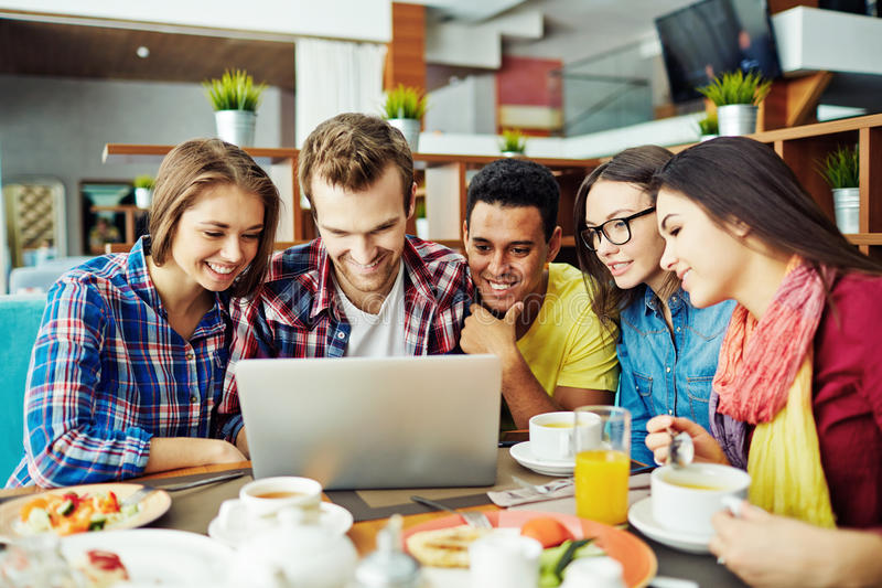 Networking. Teenage friends networking in cafe royalty free stock photography