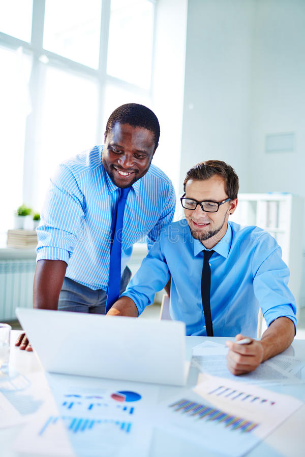 Networking. Two confident employees networking at meeting stock photo