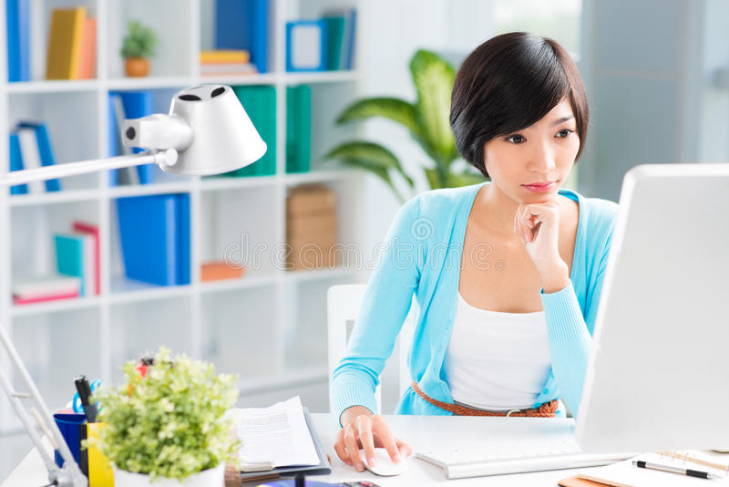 Networking. Young attractive businesswoman networking at the workplace on the foreground stock image