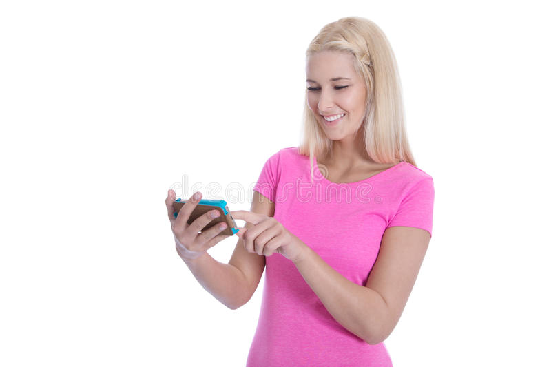 Networking: young woman chatting with her friends - isolated. Isolated attractive teenager communicating with friends on smartphone over white background stock photography