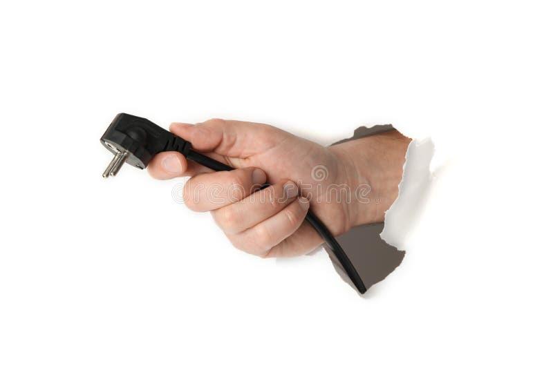 Netzstecker in der Hand auf weißem Hintergrund Energiesparendes Konzept lizenzfreie stockbilder