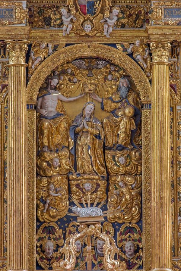 Neuber an der Murz - The carved polychrome Coronation of Virgin Mary on early baroque main altar of Dom. NEUBERG AN DER MURZ, AUSTRIA - SEPTEMBER 13, 2015: The royalty free stock photography