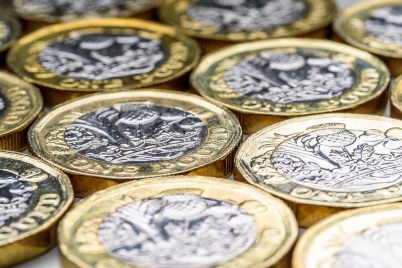 Neue Briten ein Pfund Sterling Coin Chart Rate lizenzfreie stockbilder