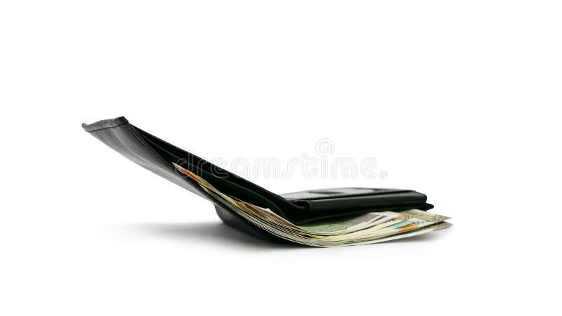 Neue indische Währung gefaltet mit Geldbörse, weißer Hintergrund, mehrfache Anmerkungen, Finanzgeschäftskonzept, erwerbend, Kaufk stockbilder