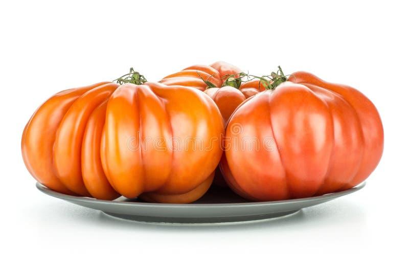 Neue rohe Tomaten-Fleischtomatevielzahl lokalisiert auf Weiß stockfotografie