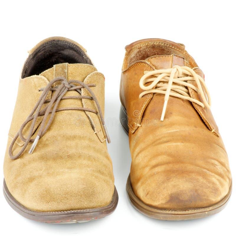 Neue und alte Schuhe lizenzfreie stockfotos