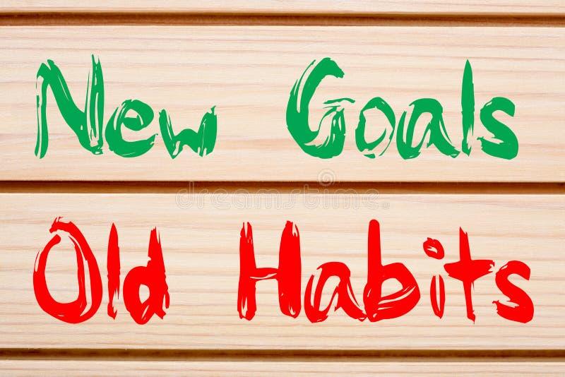 Neue Ziele gegen alte Gewohnheiten stockfotos