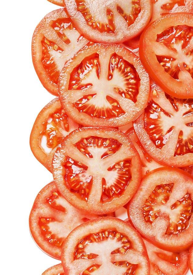 Neuer Hintergrund mit den Scheiben der Tomate lokalisiert lizenzfreies stockfoto