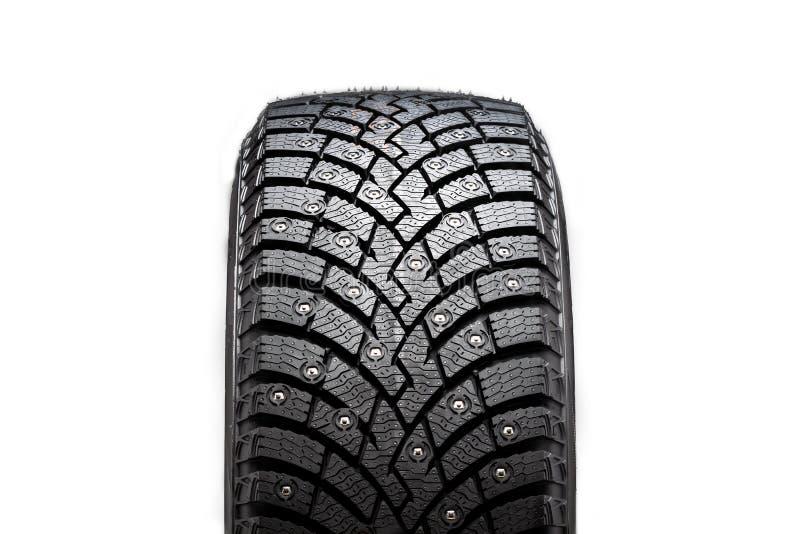 Neuer Winter verzierter Reifen, Sicherheit und erstklassige Qualität schwarzer Hintergrund, Nahaufnahme lokalisiert lizenzfreies stockfoto