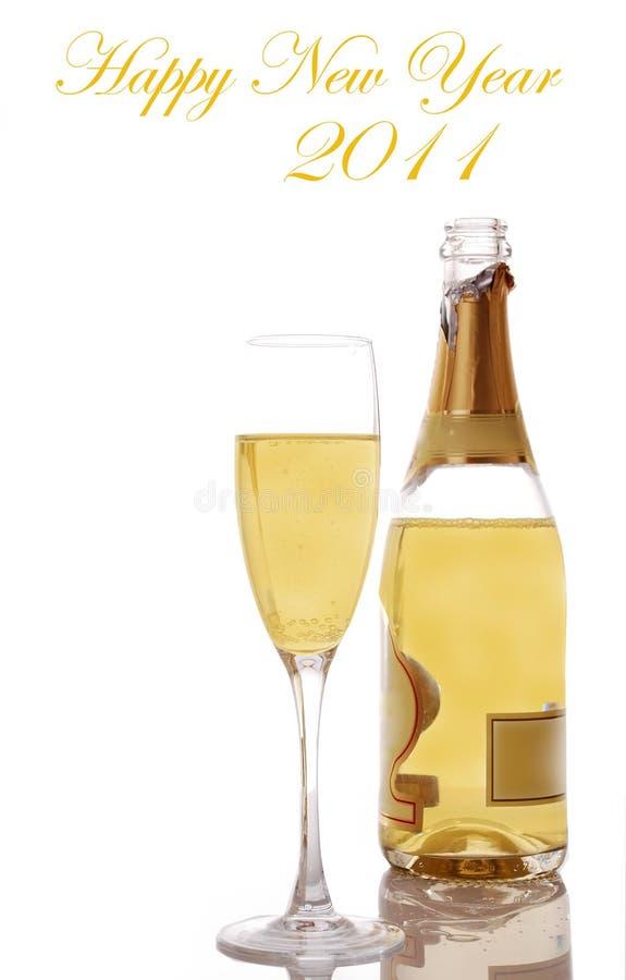neues Jahr Champagne und Glas lizenzfreie stockbilder