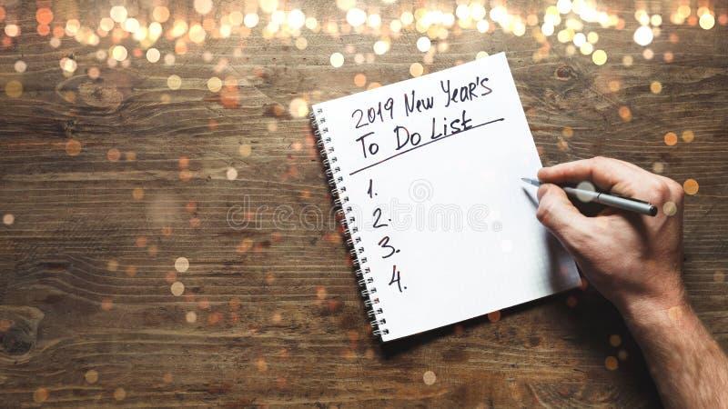 Neues Jahr Motivations-im Jahre 2019 Konzept Leute sind a, zum der Liste für nächstes Jahr mit Lichtern zu tun Körperteile, Drauf stockfotos