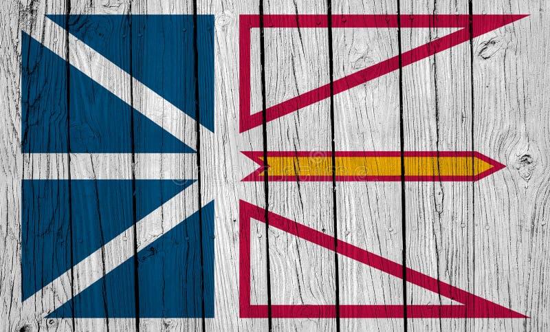 Neufundland- und Labradorflagge über Holzplanks stockbild