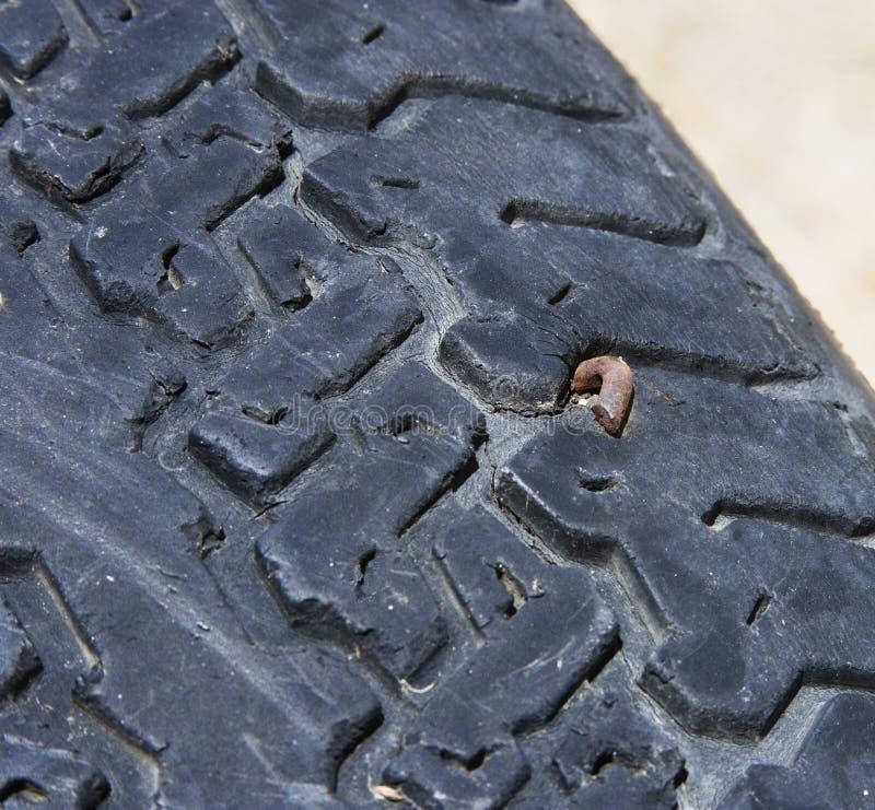 Neumático con un clavo fotos de archivo libres de regalías