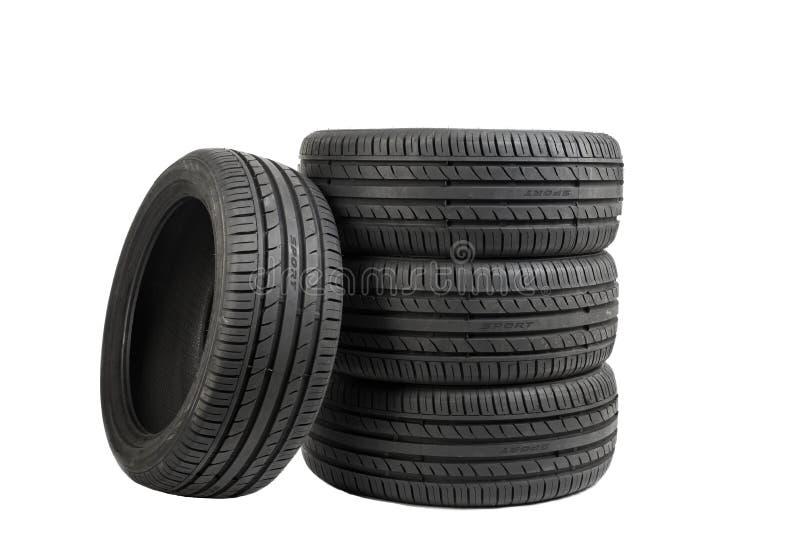 Neumáticos aislados en el efecto blanco, especial del color fotografía de archivo