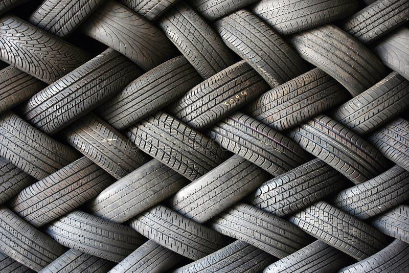 Neumáticos empilados en un modelo foto de archivo libre de regalías