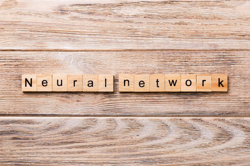 NEURAL NETWORK word written on wood block. NEURAL NETWORK text on wooden table for your desing, concept stock photo
