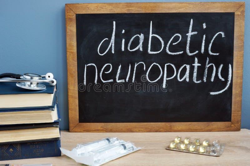 Neuropathie diabétique manuscrite sur un tableau noir photographie stock libre de droits