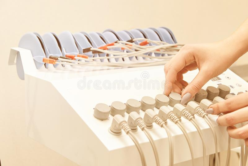 Neurostimulation massage equipment. myostimulation health. Fat slim technology. electrostimulation cellulite machine.  royalty free stock photography