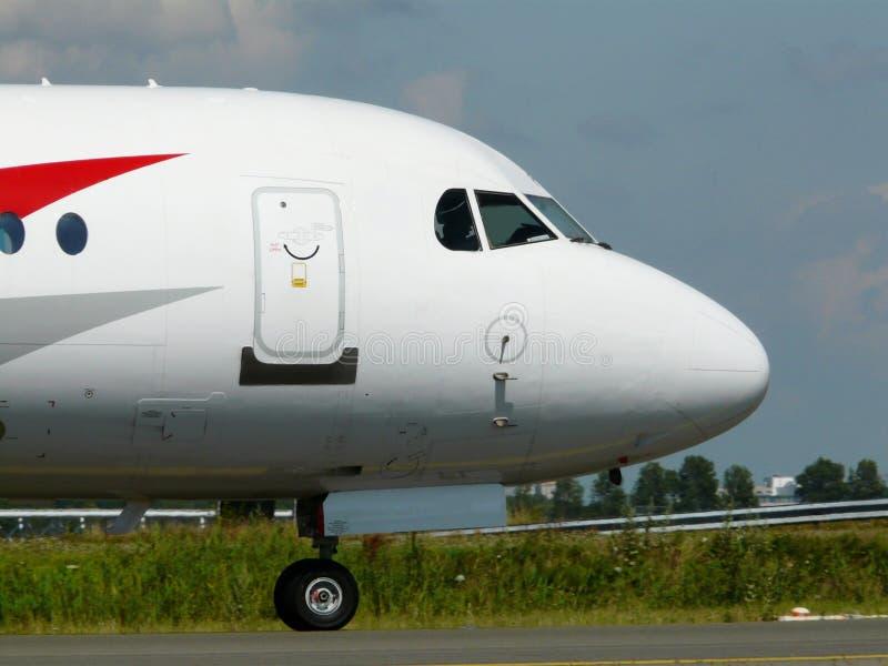 Neus van een wit vliegtuig stock afbeeldingen