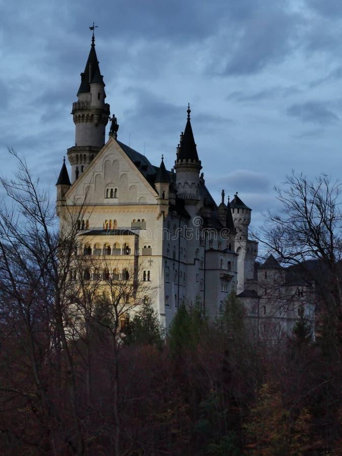 Neuschwangau castle Autumn forest twilight royalty free stock photo