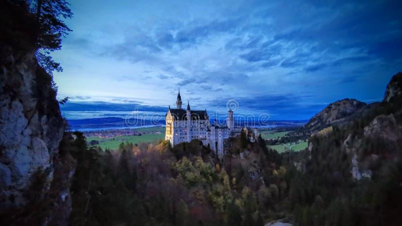 Neuschwangau castle wide angle at twilight stock photos