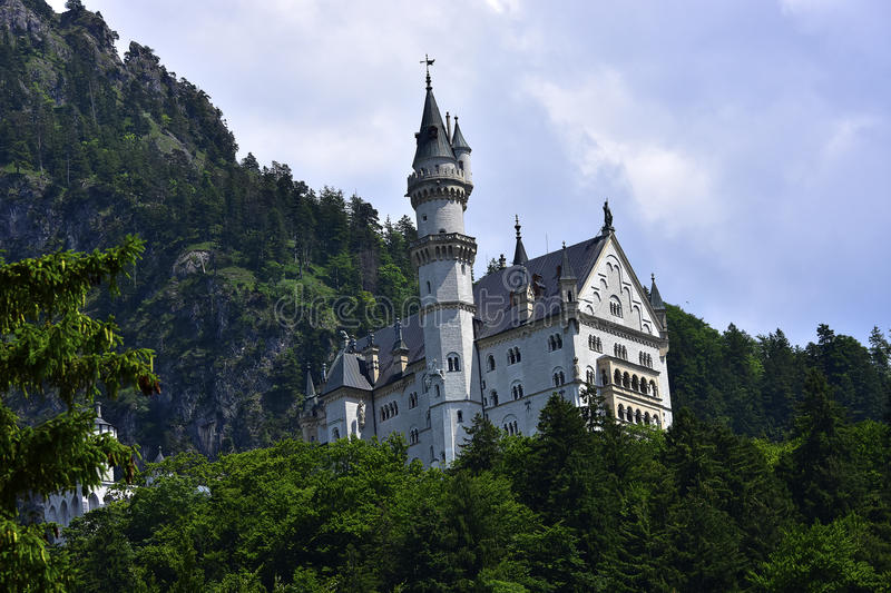 Neuschwanstein Castle. With the mountains in the background royalty free stock photos