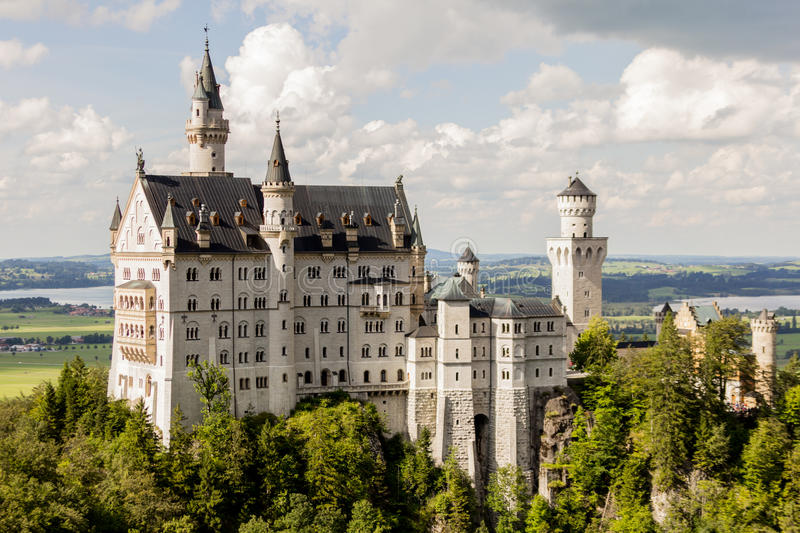 Neuschwanstein castle side view. Fair and fables concept royalty free stock image