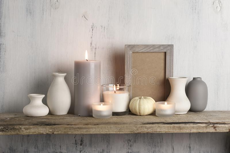 Neutral colored vases and candles as home decor stock images