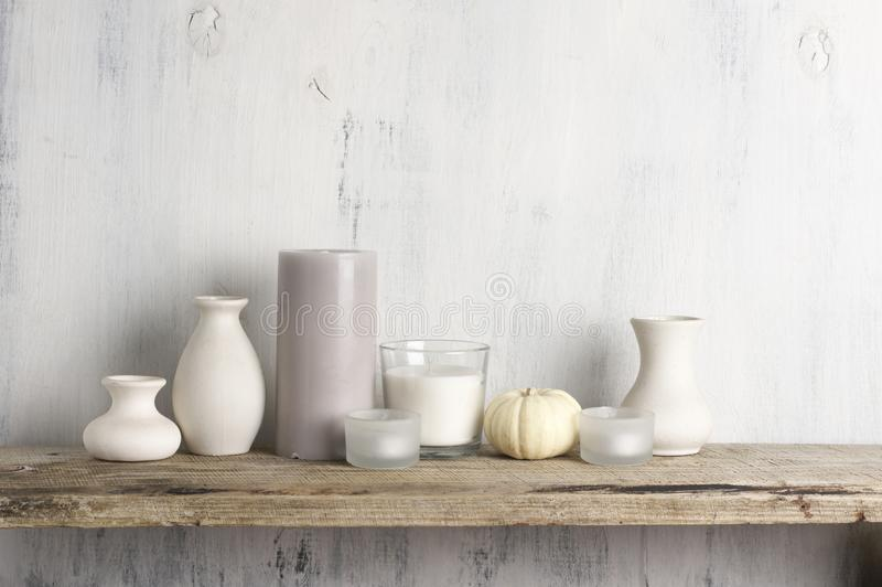 Neutral colored vases and candles as home decor royalty free stock images