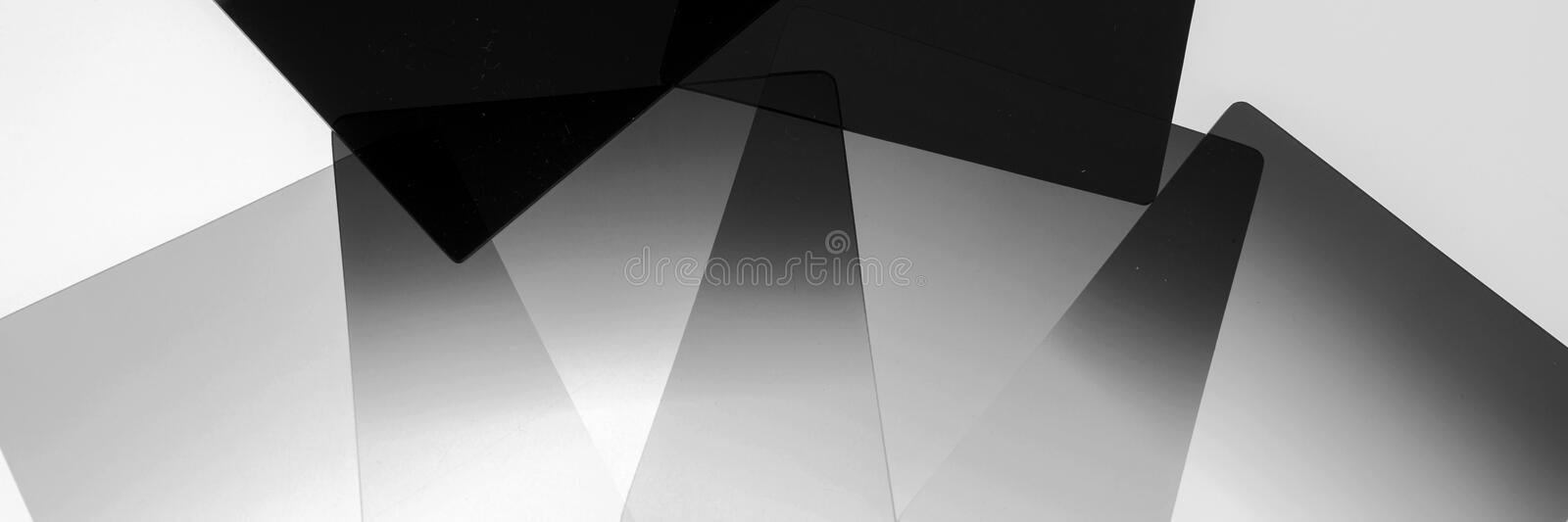 Neutral density and graduated neutral density filters used in camera for photography. Isolated on white royalty free stock photos