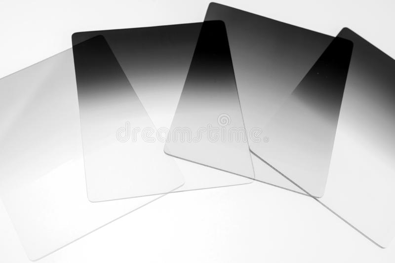Neutral density and graduated neutral density filters used in camera for photography royalty free stock photos