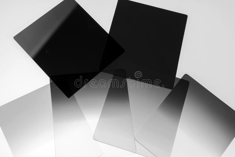 Neutral density and graduated neutral density filters used in camera for photography. Isolated on white royalty free stock photo