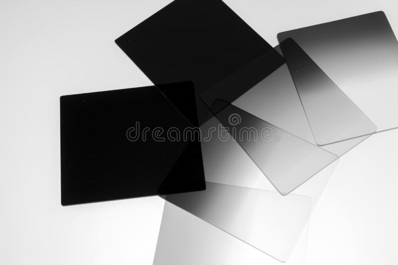 Neutral density and graduated neutral density filters used in camera for photography. Isolated on white stock image