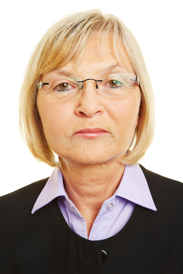 Neutral face of old woman stock photos
