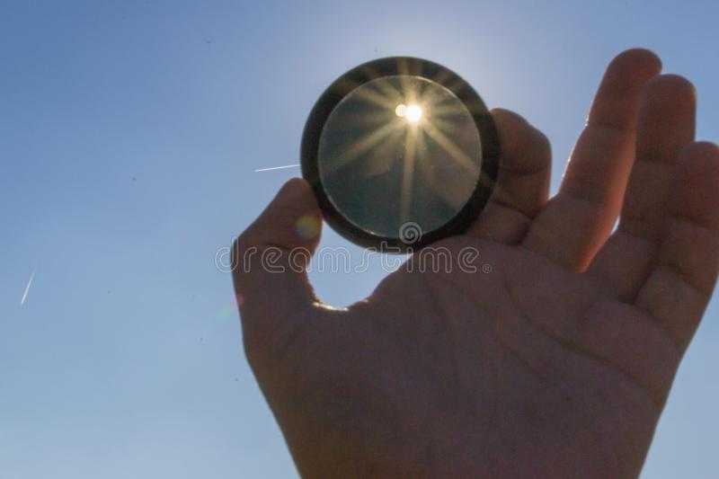 Neutral gray filter for camera. ND neutral lens filter for camera photographer stock image