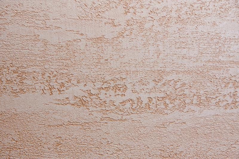 Neutral rough beige wall. Background stock images