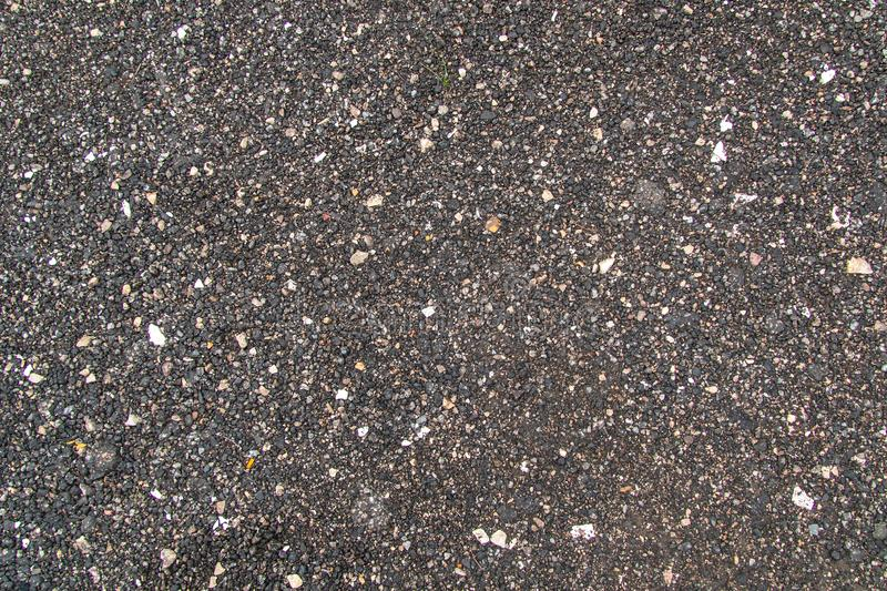 Textured pebbles of dark neutral color stock photo