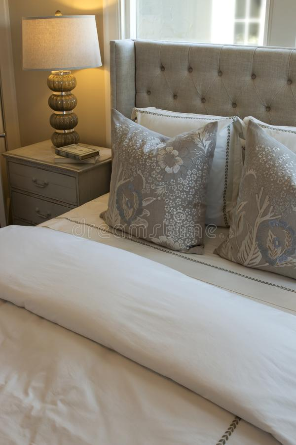 Neutral Themed Bedding and Linens. Neutral, beige themed bedding, pillows, cushions and linens stock images