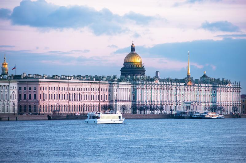 Neva embankment with the Hermitage museum in Saint-Petersburg at White nights time. Neva river, ferries on the river, embankment with the Hermitage museum, at stock image