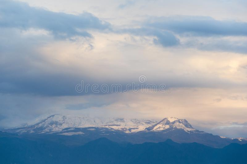 Nevado del Ruiz, a Colombian snow-covered volcano, under a cloudy sky royalty free stock photography