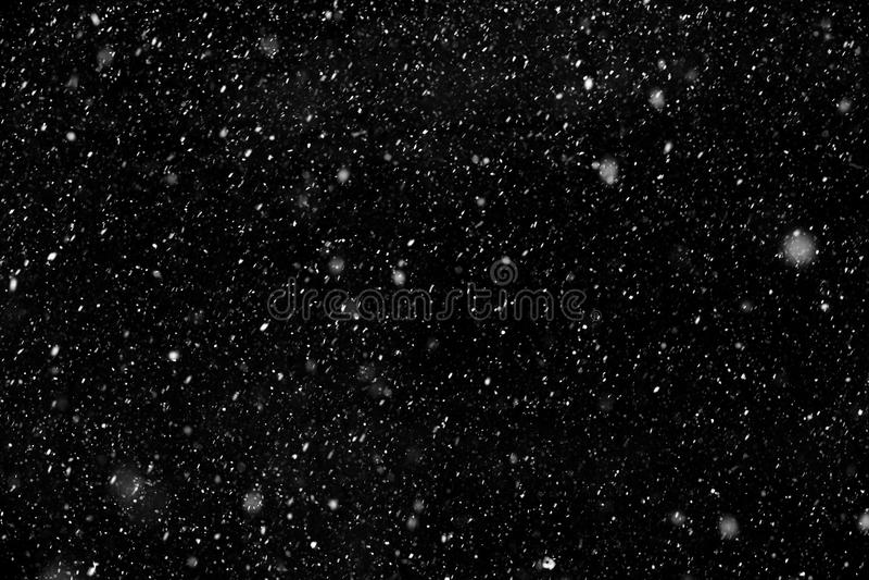 Neve branca no fundo preto foto de stock