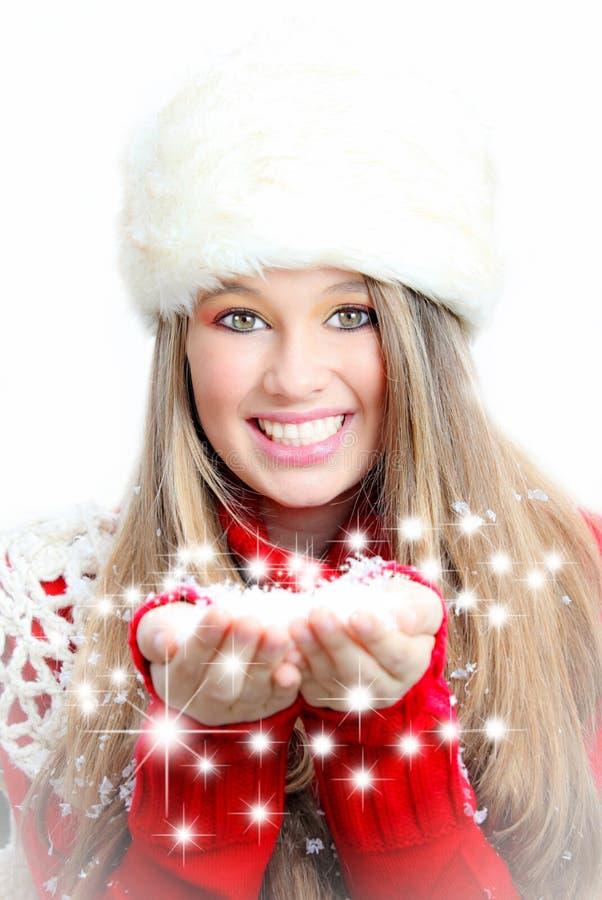 Neve de sopro e desejos da mulher do inverno do Natal fotos de stock royalty free