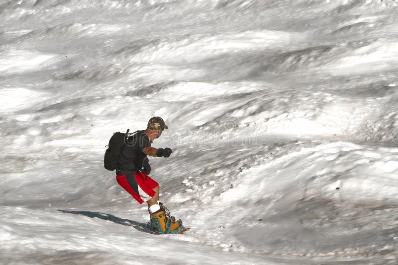 Neve della primavera che pratica il surfing 3 fotografia stock libera da diritti
