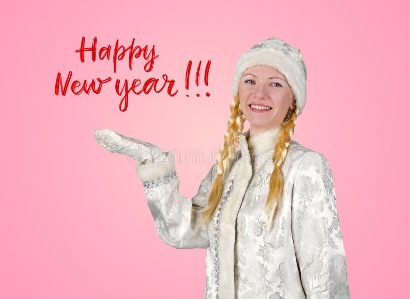Neve nova em um fundo cor-de-rosa com uma inscrição congratulatório foto de stock royalty free