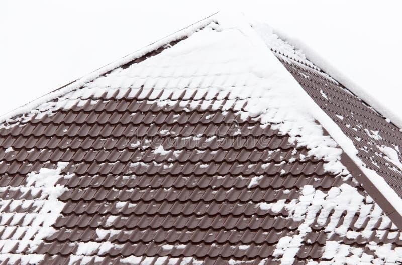 Neve sul tetto della casa fotografia stock libera da diritti